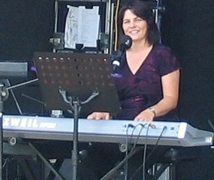 Nicole playing piano at Concert in the Orchard